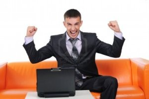 7989080-business-man-who-achieved-success-on-an-orange-sofa